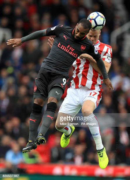 Arsenal's Alexandre Lacazette and Stoke City's Ryan Shawcross battle for the ball during the Premier League match at the bet365 Stadium Stoke