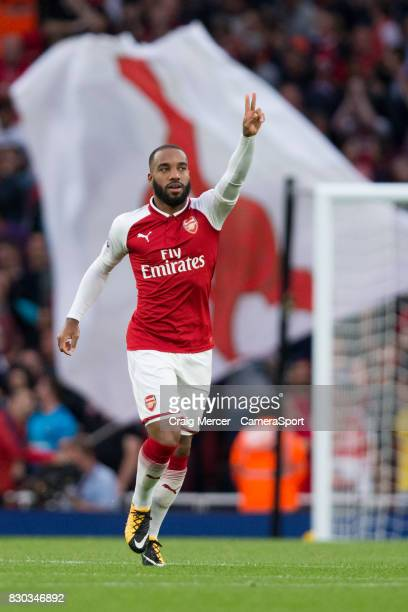 Arsenal's Alexandre Lacazette celebrates scoring the opening goal during the Premier League match between Arsenal and Leicester City at Emirates...