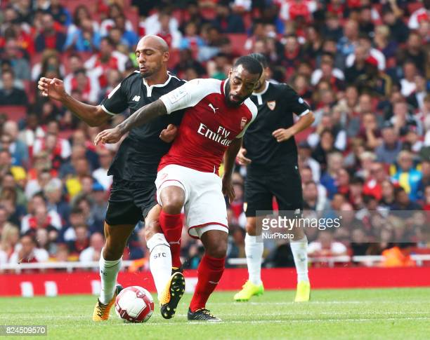 Arsenal's Alexandre Lacazette holds of Steven N'Zonzi of Sevilla FC during Emirates Cup match between Arsenal against Savilla FC at Emirates Stadium...