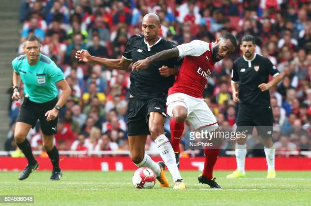 Arsenal's Alexandre Lacazette holds of Steven N'Zonzi of Sevilla FC during Emirates Cup match between Arsenal against Savilla FC at The Emirates...