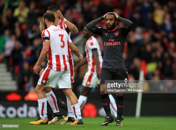 Arsenal's Alexandre Lacazette is dejected during the Premier League match at the bet365 Stadium Stoke