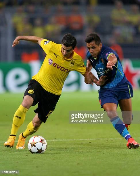 Arsenal's Alexis Sanchez and Borussia Dortmund's Henrikh Mkhitaryan battle for the ball