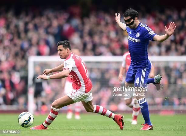 Arsenal's Alexis Sanchez and Chelsea's Cesc Fabregas battle for the ball
