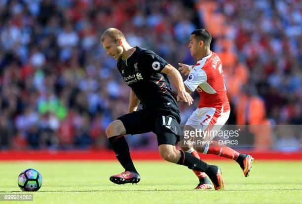 Arsenal's Alexis Sanchez and Liverpool's Ragnar Klavan battle for the ball