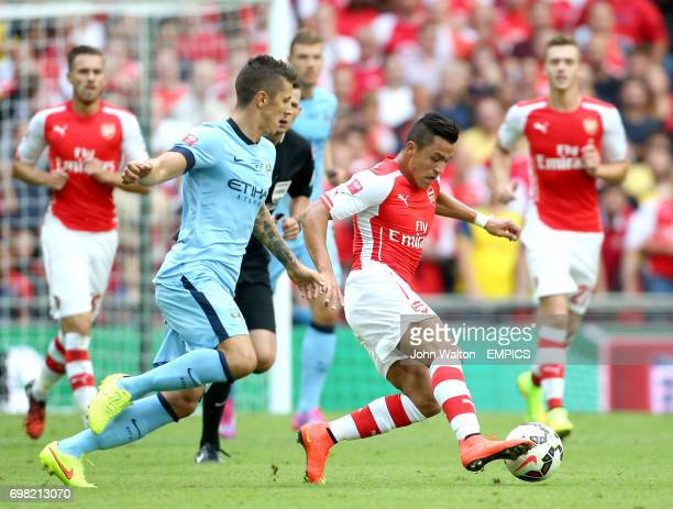 Arsenal's Alexis Sanchez and Manchester City's Stevan Jovetic battle for the ball