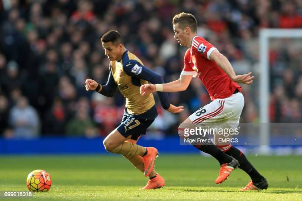 Arsenal's Alexis Sanchez and Manchester United's Morgan Schneiderlin battle for the ball