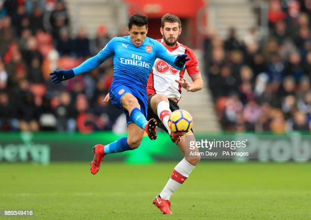 Arsenal's Alexis Sanchez and Southampton's Jack Stephens battle for the ball during the Premier League match at St Mary's Stadium Southampton