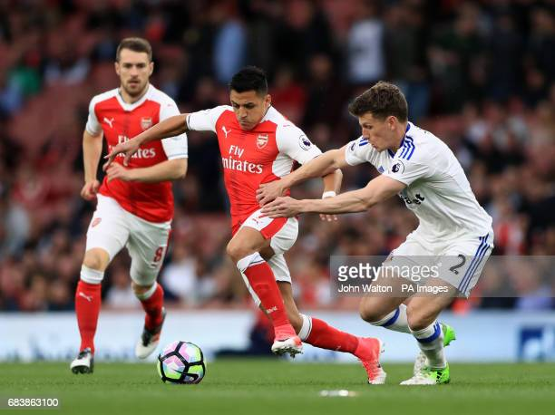 Arsenal's Alexis Sanchez and Sunderland's Billy Jones battle for the ball during the Premier League match at the Emirates Stadium London