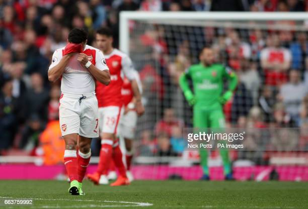 Arsenal's Alexis Sanchez and teammates stand dejected after Manchester City's Sergio Aguero scores his side's second goal of the game during the...