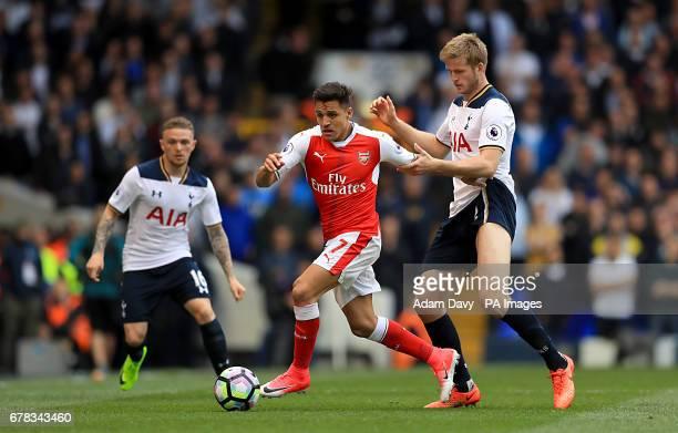 Arsenal's Alexis Sanchez and Tottenham Hotspur's Eric Dier battle for the ball