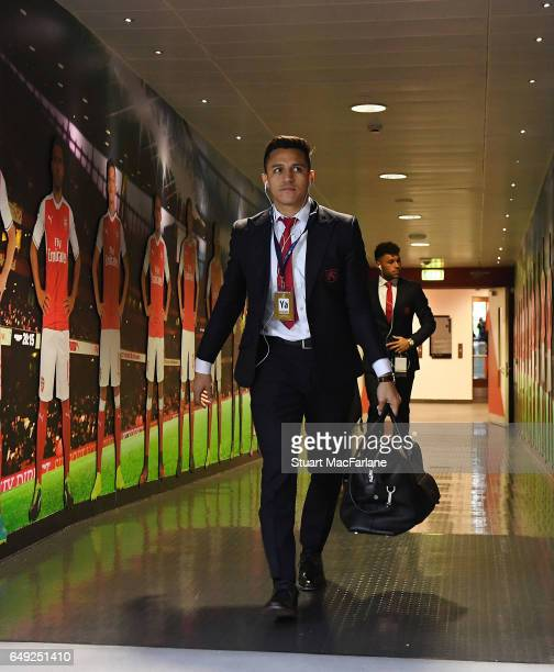 Arsenal's Alexis Sanchez arrives at the home changing room before the UEFA Champions League Round of 16 second leg match between Arsenal FC and FC...