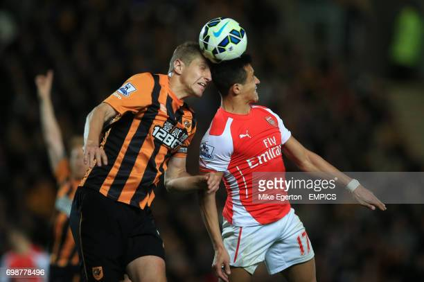 Arsenal's Alexis Sanchez battles for the ball with Hull City's Michael Dawson