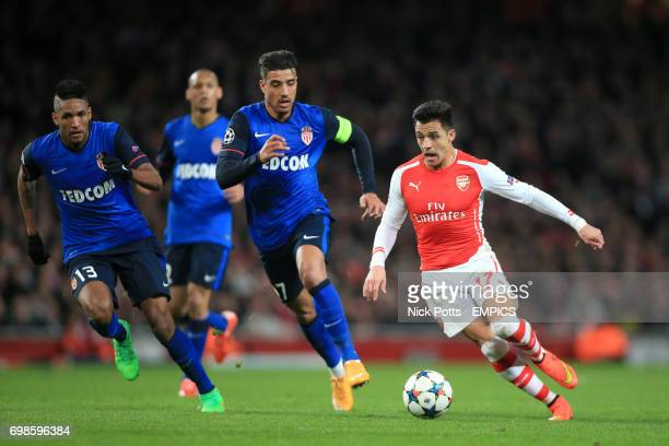 Arsenal's Alexis Sanchez breaks clear of Monaco's Nabil Dirar and Wallace