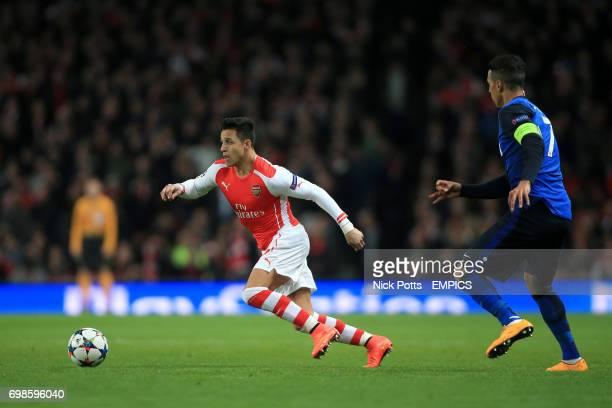 Arsenal's Alexis Sanchez breaks clear of Monaco's Nabil Dirar