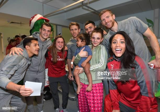Arsenal's Alexis Sanchez Granit Xhaka Heather O'Reilly Nacho Monreal Sead Kolasinac Per Mertesacker and Alex Scott visit the Whittington Hospital on...