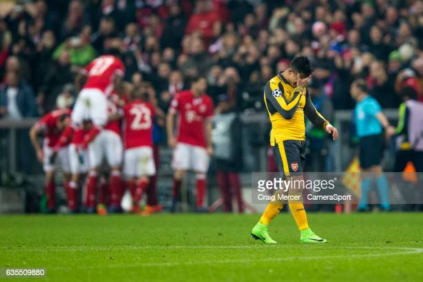 Arsenal's Alexis Sanchez looks dejected after his side concede their third goal to make the score 31 during the UEFA Champions League Round of 16...