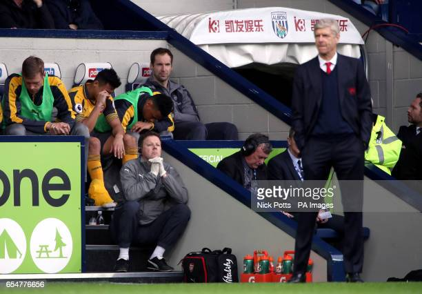Arsenal's Alexis Sanchez on the bench as manager Arsene Wenger stands on the touchline during the Premier League match at The Hawthorns West Bromwich