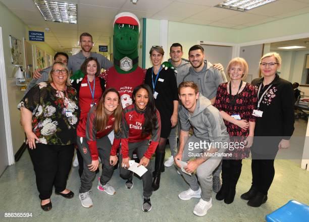 Arsenal's Alexis Sanchez Per Mertesacker Heather O'Reilly Alex Scott Granit Xhaka Nacho Monreal and Sead Kolasinac with the staff at the Whittington...