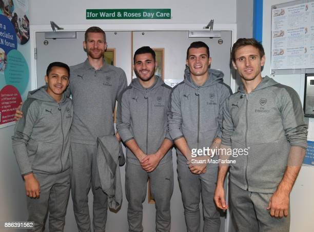 Arsenal's Alexis Sanchez Per Mertesacker Sead Kolasinac Granit Xhaka and Nacho Monreal visit the Whittington Hospital on December 5 2017 in London...