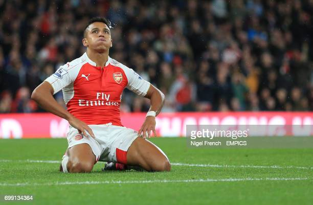 Arsenal's Alexis Sanchez reacts after his shot is saved by Liverpool goalkeeper Simon Mignolet