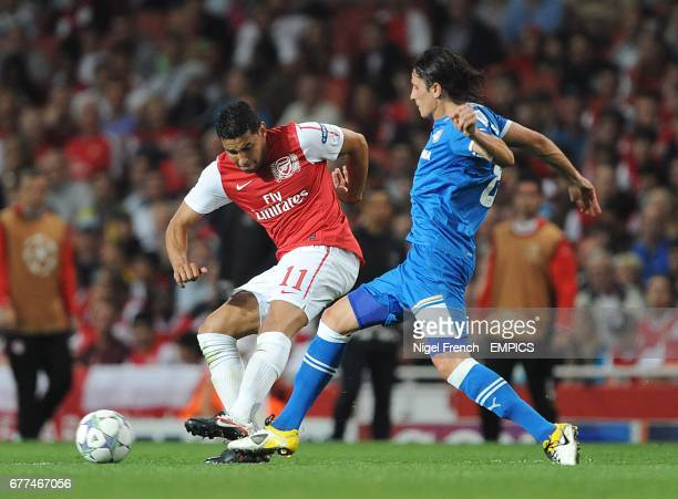 Arsenal's Andre Santos and Olympiakos' Lubomir Fejsa in action