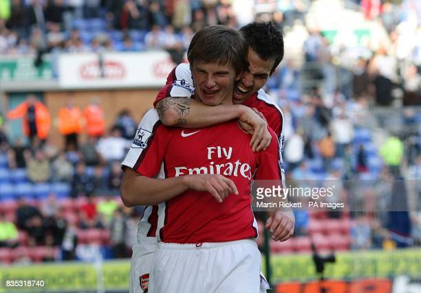 Arsenal's Andrey Arshavin celebrates with team mate Cesc Fabregas after scoring the third goal