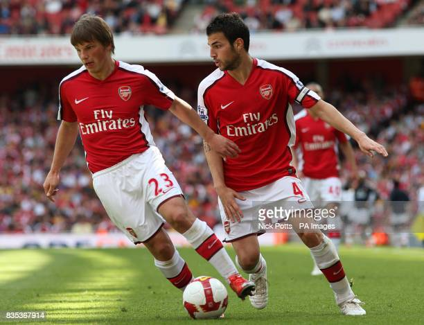 Arsenal's Andrey Arshavin takes the ball off team mate Francesc Fabregas