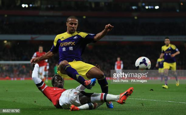 Arsenal's Bacary Sagna and Swansea City's Wayne Routledge battle for the ballduring the Barclays Premier League match at the Emirates Stadium London