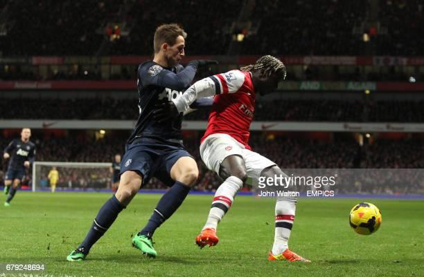 Arsenal's Bacary Sagna holds off Manchester United's Adnan Januzaj