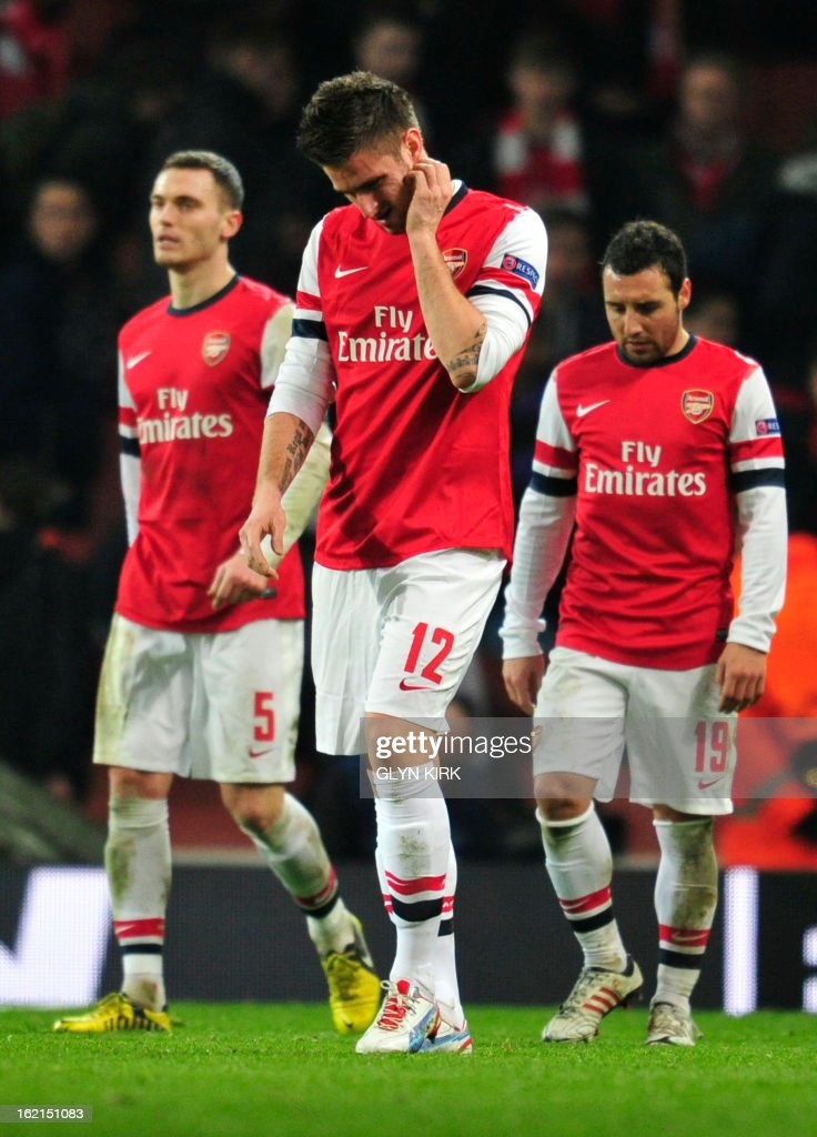Arsenal's Belgian defender Thomas Vermaelen (L), Arsenal's French striker Olivier Giroud (C) and Arsenal's Spanish midfielder Santi Cazorla (R) reacts at the final whistle after losing the UEFA Champions League round of 16 football match between Arsenal and Bayern Munich at the Emirates Stadium in north London on February 19, 2013.