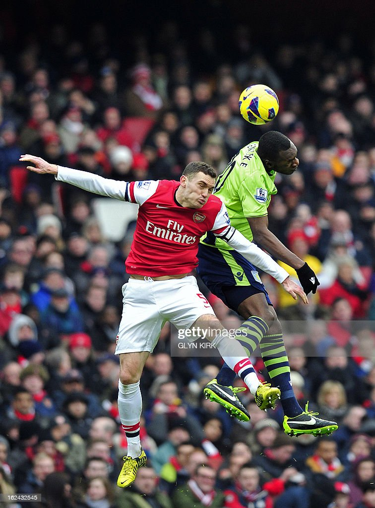 "Arsenal's Belgian defender Thomas Vermaelen (L) vies with Aston Villa's Belgian striker Christian Benteke (R) during their English Premier League football match at the Emirates Stadium in London, England on February 23, 2013. Arsenal won the game 2-1. USE. No use with unauthorized audio, video, data, fixture lists, club/league logos or ""live"" services. Online in-match use limited to 45 images, no video emulation. No use in betting, games or single club/league/player publications."
