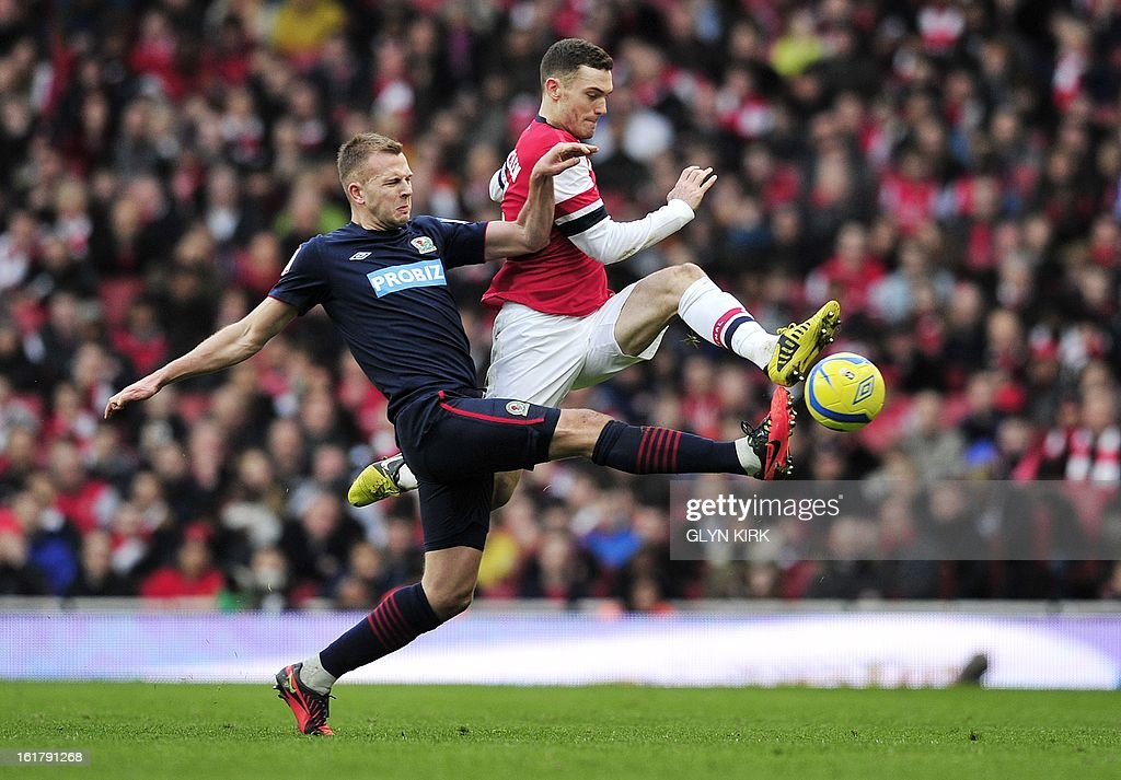 Arsenal's Belgian defender Thomas Vermaelen (R) vies with Blackburn Rovers' Scottish striker Jordan Rhodes (L) during the English FA Cup fifth round football match between Arsenal and Blackburn Rovers at the Emirates Stadium in London on February 16, 2013. AFP PHOTO/GLYN KIRK USE. No use with unauthorized audio, video, data, fixture lists, club/league logos or 'live' services. Online in-match use limited to 45 images, no video emulation. No use in betting, games or single club/league/player publications.