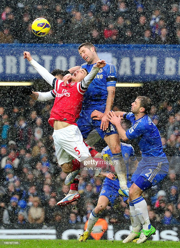 """Arsenal's Belgian defender Thomas Vermaelen (L) vies with Chelsea's English defender Gary Cahill (C) during the English Premier League football match between Chelsea and Arsenal at Stamford Bridge in London on January 20, 2013. USE. No use with unauthorized audio, video, data, fixture lists, club/league logos or """"live"""" services. Online in-match use limited to 45 images, no video emulation. No use in betting, games or single club/league/player publications."""