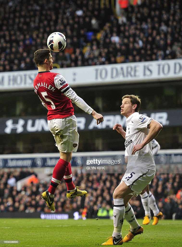 """Arsenal's Belgian defender Thomas Vermaelen (L) vies with Tottenham Hotspur's Belgian defender Jan Vertonghen (R) during the English Premier League football match between Tottenham Hotspur and Arsenal at White Hart Lane in north London on March 3, 2013. USE. No use with unauthorized audio, video, data, fixture lists, club/league logos or """"live"""" services. Online in-match use limited to 45 images, no video emulation. No use in betting, games or single club/league/player publications"""