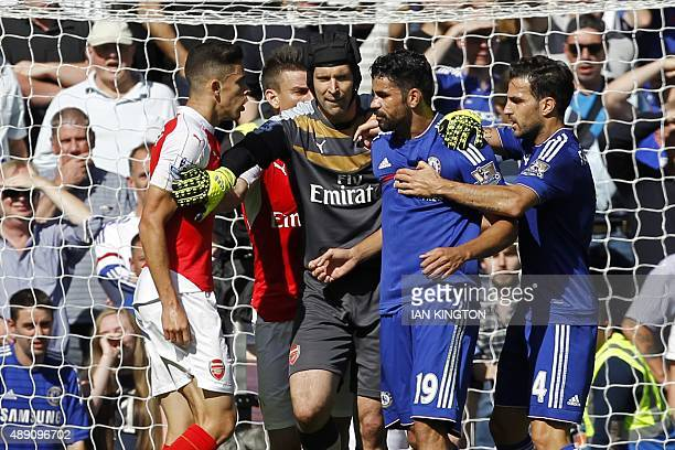 Arsenal's Brazilian defender Gabriel and Chelsea's Brazilianborn Spanish striker Diego Costa are separated by Arsenal's Czech goalkeeper Petr Cech as...
