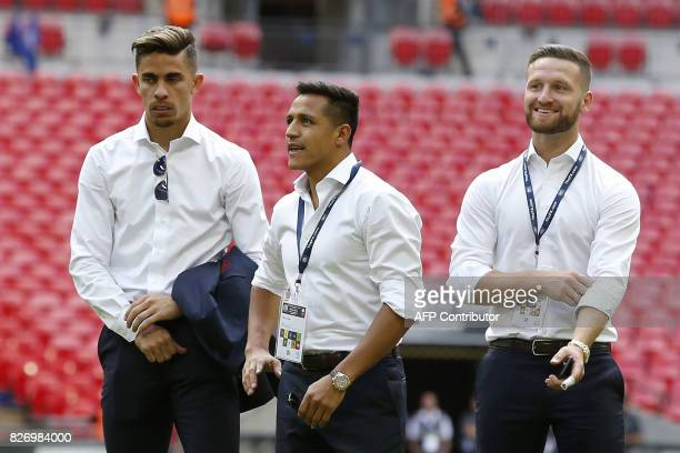 Arsenal's Brazilian defender Gabriel Arsenal's Chilean striker Alexis Sanchez and Arsenal's German defender Shkodran Mustafi look on after the team's...