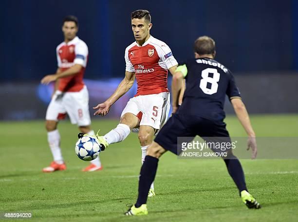 Arsenal's Brazilian defender Gabriel Paulista vies with Dinamo Zagreb's Croatian midfielder Domagoj Antolic during the UEFA Champions League Group F...