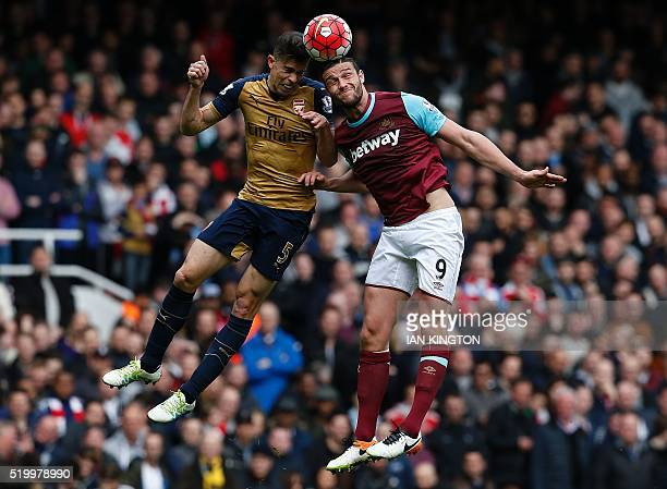 Arsenal's Brazilian defender Gabriel vies in the air with West Ham United's English striker Andy Carroll during the English Premier League football...