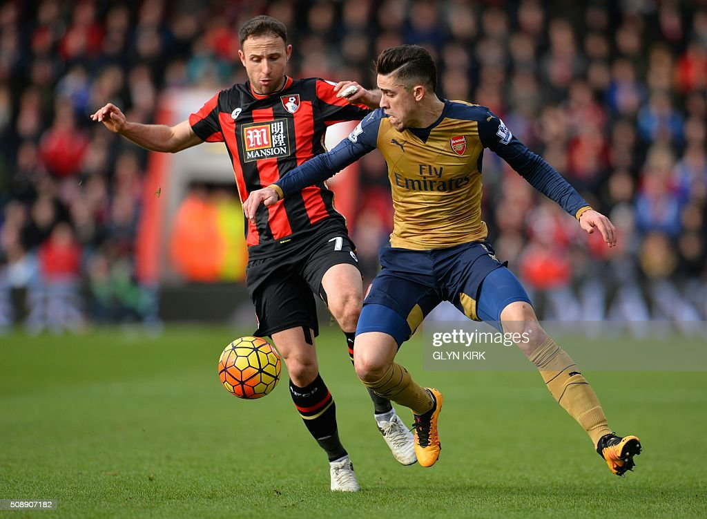 Arsenal's Brazilian defender Gabriel (R) vies with Bournemouth's English midfielder Marc Pugh during the English Premier League football match between Bournemouth and Arsenal at the Vitality Stadium in Bournemouth, southern England on February 7, 2016. / AFP / GLYN KIRK / RESTRICTED TO EDITORIAL USE. No use with unauthorized audio, video, data, fixture lists, club/league logos or 'live' services. Online in-match use limited to 75 images, no video emulation. No use in betting, games or single club/league/player publications. /