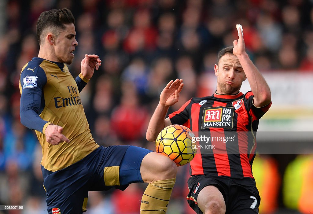 Arsenal's Brazilian defender Gabriel (L) vies with Bournemouth's English midfielder Marc Pugh during the English Premier League football match between Bournemouth and Arsenal at the Vitality Stadium in Bournemouth, southern England on February 7, 2016. / AFP / GLYN KIRK / RESTRICTED TO EDITORIAL USE. No use with unauthorized audio, video, data, fixture lists, club/league logos or 'live' services. Online in-match use limited to 75 images, no video emulation. No use in betting, games or single club/league/player publications. /
