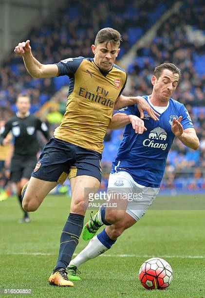 Arsenal's Brazilian defender Gabriel vies with Everton's English defender Leighton Baines during the English Premier League football match between...