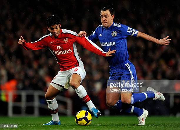 Arsenal's Brazilian forward Eduardo vies for the ball against Chelsea's John Terry during the Premiership match at the Emirates Stadium in London on...