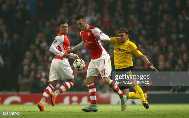 Arsenal's Calum Chambers and Borussia Dortmund's Marcel Schmelzer battle for the ball
