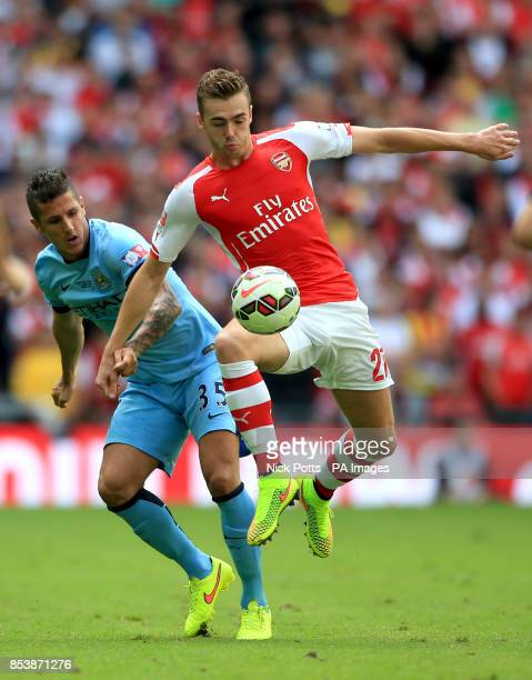 Arsenal's Calum Chambers wins the ball beating Manchester City's Stevan Jovetic