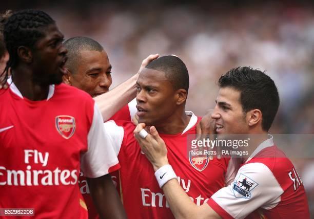Arsenal's Cesar Julio Baptista celebrates after scoring the opening goal of the match with team mates Emmanuel Adebayor and Francesc Fabregas and...