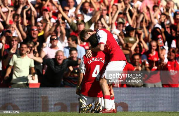 Arsenal's Cesc Fabregas celebrates his winning goal with fans and Alexander Hleb during the Barclays Premier League match at the Emirates Stadium...