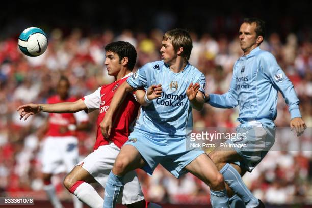 Arsenal's Cesc Fabregas holds off Manchester City's Michael Johnson and Dietmar Hamann during the Barclays Premier League match at the Emirates...