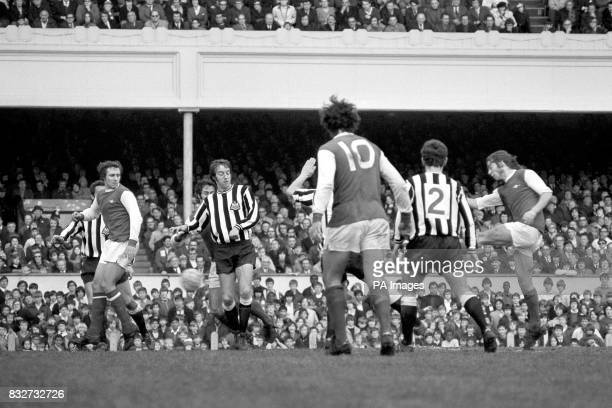 Arsenal's Charlie George fires home the winning goal watched by teammates John Radford and Ray Kennedy and Newcastle United's Frank Clark and Bobby...
