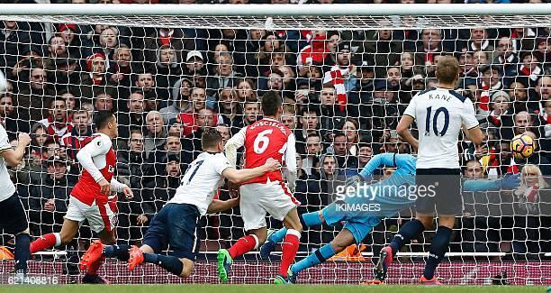 Arsenal's Chilean striker Alexis Sanchez and Arsenal's French defender Laurent Koscielny watch as Tottenham Hotspur's Austrian defender Kevin Wimmer...
