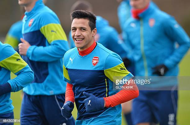 Arsenal's Chilean striker Alexis Sanchez attends a training session at Arsenal's training ground in London Colney north of London England on February...